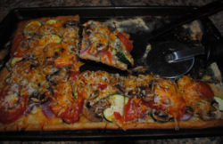 Here is a recipe for a homemade delicious 3 cheese veggie pizza.
