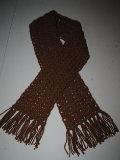 A beautiful scarf knitted from alpaca fibers.