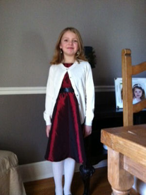 Amelia makes her own Christmas dress for her school concert.