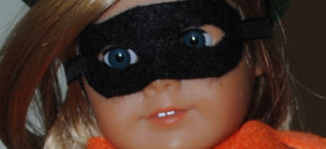 Use black felt to make the Halloween mask for your American girl doll pumpkin costume.