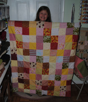 Anneleise sews up her very first quilt.
