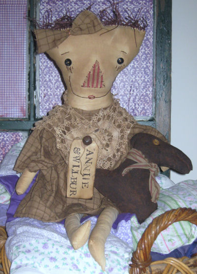 Handmade primitive raggedy annie doll with chocolate bunny doll.