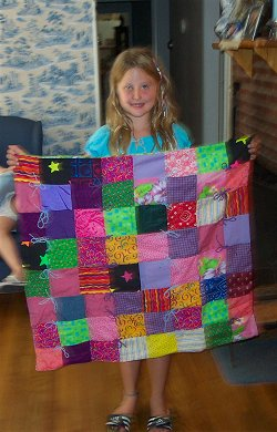 Becca makes her very first quilt.