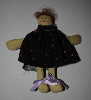 Gather the top of the dolls dress and cut slits on the side.