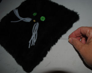 When working with fur seams after sewing, run a pin through the seam gently pulling up the fur.