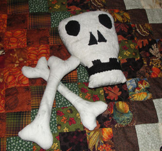 Handmade fabric skull and bones for a Halloween craft.