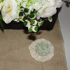 You can even add decorative cardstock paper cut into circles on top of your fabric rosette.