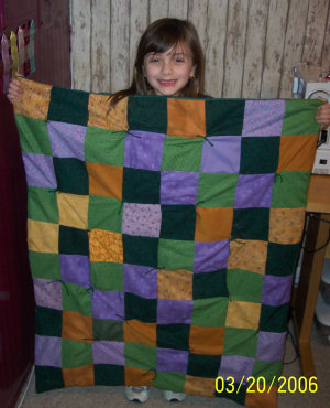 Seven year old Cami sews up her very first quilt.