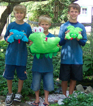 The boys stitched up frogs and snake creatures.