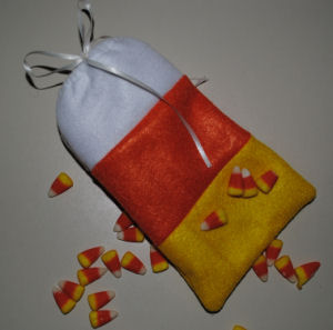 This felt candy corn bag is perfect to place Halloween treats in and it is very easy to make.