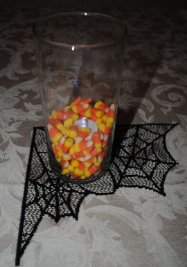 Add candy corn to the bottom of a clear vase for a neat Halloween decoration.