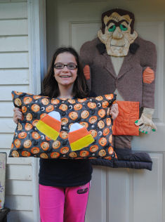Chelsea makes her candy corn pillow for Halloween decorating.
