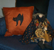 Learn to sew a cute black cat silhoutte Halloween Pillow with these free directions.