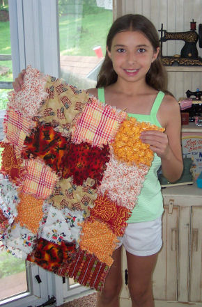 Christina made a raggedy quilt for her doll.