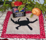 How to sew a crabby silhouette quilted hot pad.