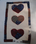 How to make a quilted crazy heart table runner for 4th of July.