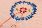Information on cross-stitch crafting.
