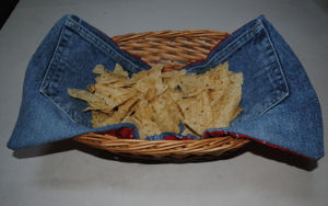 Recycle your old jeans into a reversible denim basket napkin for your next picnic.