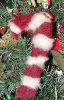 Candycane ornament made by needle felting using dyed sheeps wool.