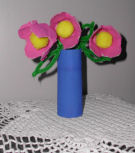 A mother's day craft for kids, egg carton cups turn into a pretty bouquet of flowers.