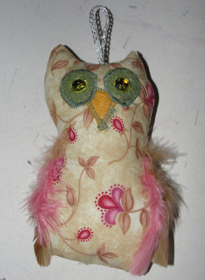 "Watching Legally Blonde got me in the mood to design this pretty little owl ornament. I named her ""Elle"", the Woods owl."