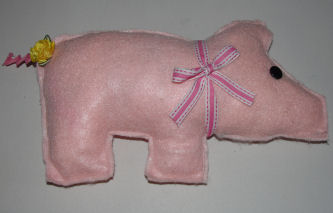 A cute little stuffed pig - you can buy this sewing kit and make one for yourself.