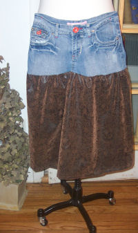 Erika redesigned this skirt from an old pair of denim jeans by adding a gathered ultra suede fabric at the bottom.