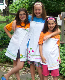 Girls design and sew themselves a terry cloth cover-up.