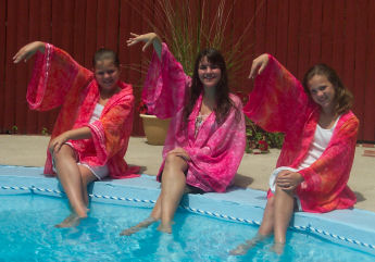 Girls make the pool cover-up from HSM 2.