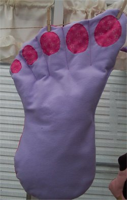 A big foot pillow sewn from felt.