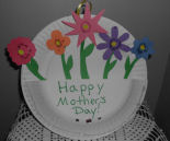 Here is a charming basket of flowers Mother's day craft made from paper plates for kids to make their moms.