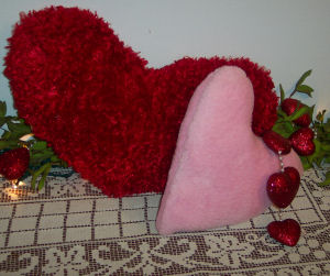 You can sew these cute big pink and red fur heart pillow for Valentine's day.