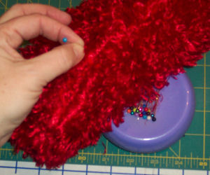 Pick up the fur in the seam with a pin or brush.