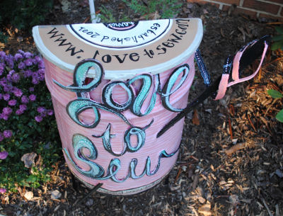 Beautiful garden art for sewing a spool of thread made from metal for Love to Sew Studio.