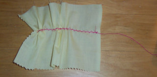 Learn how to gather fabric by a strong zigzag machine stitch.