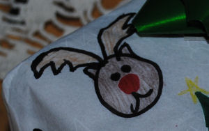 Have your child draw on white paper a Christmas scene to make their very own wrapping paper for gifts.