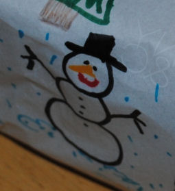 A cute snowman drawn by a child and turned into wrapping paper.