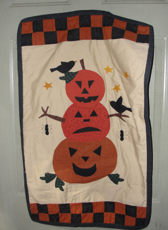 Pumpkin man Halloween quilt with spiders and jack-o-lanterns, love to sew.