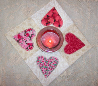 Valentine's Day Sewing Project: How to make a country heart quilted candle mat.