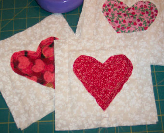 Learn to sew Valentine raggedy heart coasters.