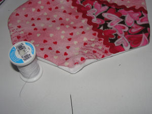 Hand sew the opening closed on the fabric heart.
