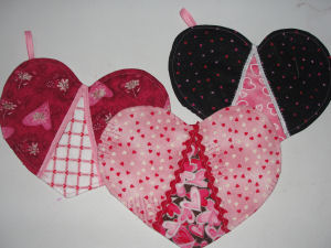 You can use your Valentine quilted hearts as a doily, a candle mat, or a pot holder.