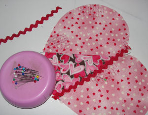 Add rick-rack or ribbon to the heart craft.