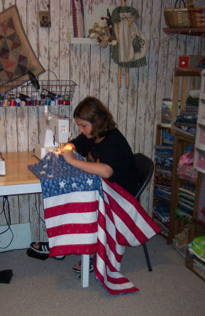 This beautiful patriotic flag quilt is proudly hung in the family den!