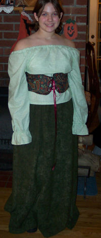 The sewn renaissance gown was made by sewing a long skirt, peasant blouse, and a waist cincher