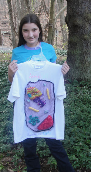 Jacquelyn sews her cell project for school on a t-shirt.