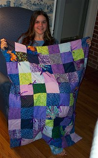 Jamie makes her first quilt in purple, blue, and green to go in her dolphin room!