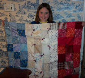 "Katherine stitches up a red, white, and blue patriotic quilt of 5"" squares."