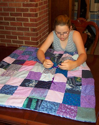 Kelly made this pretty purple and blue patchwork quilt.
