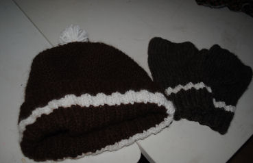 Brown and white strip hat and matching fingerless gloves made from Alpaca fibers.